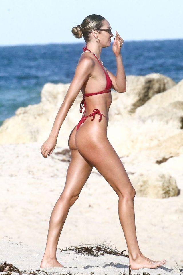 Candice Swanepoel kırmızı bikini ile Miami plajında