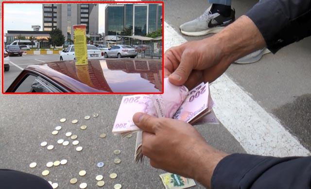 Aracının üzerinde para dolu cips kutusu buldu, polise teslim etti