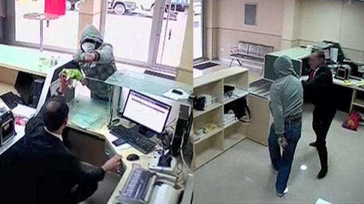PTT çalışanı, bıçaklı soyguncuya direndi