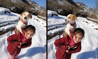 9 yaşındaki Cemre, rahatsızlanan köpeğini sırtında veterinere götürdü