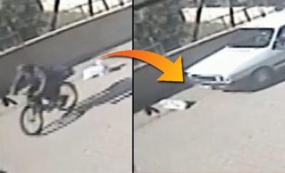 Adana'da bisikletlinin yola attığı torbadaki köpeği otomobil ezdi