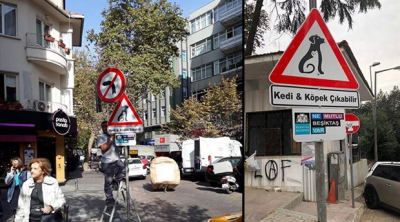 Beşiktaş'ta sokaklara 'kedi ve köpek çıkabilir' tabelaları asıldı