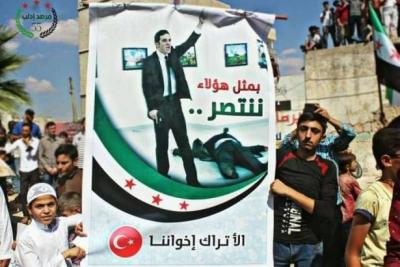İdlib'deki cihatçılar Karlov'un katilinin posterini taşıdı